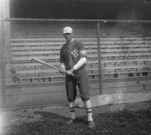A Kosciuszko Reds player poses with his bat